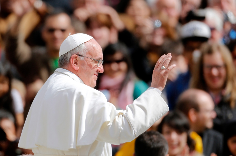 Pope Francis waves to faithful after celebrating his first Easter Mass in St. Peter's Square at the Vatican, Sunday, March 31, 2013. (AP / Andrew Medichini)