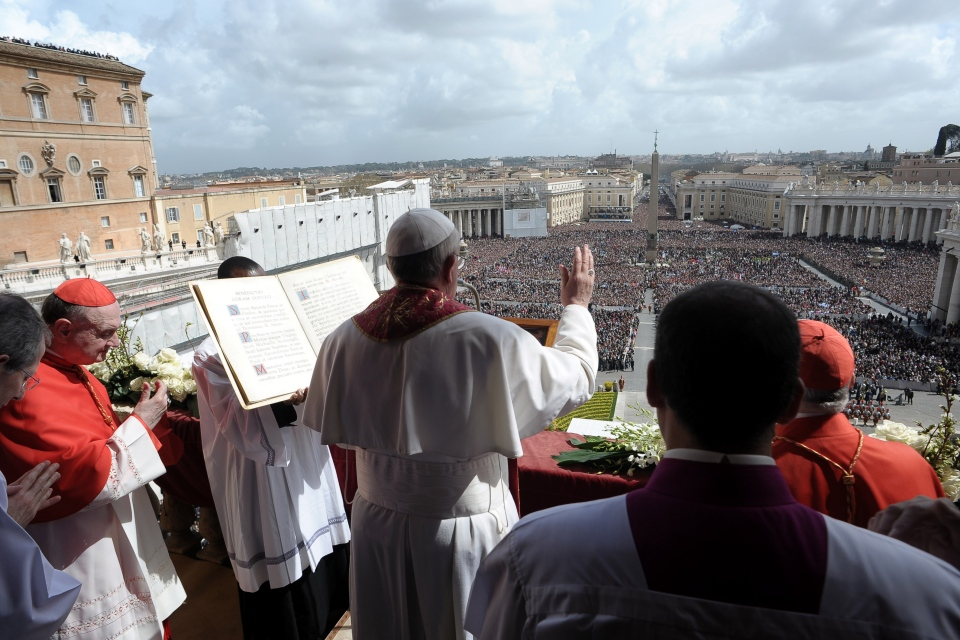 Pope Francis delivers the Urbi et Orbi (to the city and to the world) blessing, in St. Peter's Square at the Vatican, Sunday, March 31, 2013. (L'Osservatore Romano)