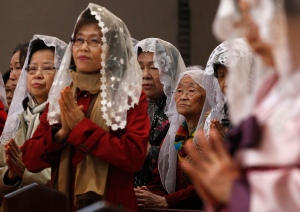 Christians around the world gather to take part in Easter Sunday traditions.<br><br>South Korean Catholics pray for peace on the Korean Peninsula during an annual Easter service at Myeongdong Catholic Cathedral in Seoul, South Korea, Sunday, March 31, 2013. (AP / Ahn Young-joon)