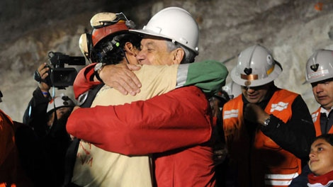 In this photo released by the Chilean presidential press office, Chile's President Sebastian Pinera, front right, hugs rescued miner Florencio Avalos after Avalos was rescued from the the collapsed San Jose gold and copper mine where he was trapped with 32 other miners for over two months near Copiapo, Chile, Tuesday Oct. 12, 2010. (AP / Jose Manuel de la Maza, Chilean presidential press office)