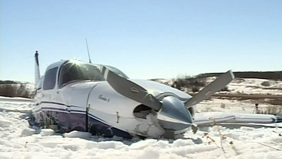 A small plane remains in a field in southeast Saskatchewan where it crashed Sunday, March 31, 2013.