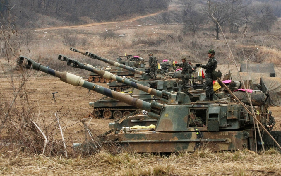 South Korean marines stand on their K-55 self-propelled howitzers during an exercise against possible attacks by North Korea near the border village of Panmunjom in Paju, South Korea Monday, April 1, 2013. (AP / Ahn Young-joon)