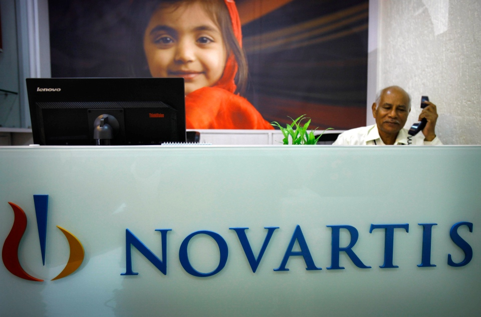 A receptionist sits in the front office of Novartis in Mumbai, India, Monday, April 1, 2013. (AP / Rafiq Maqbool)