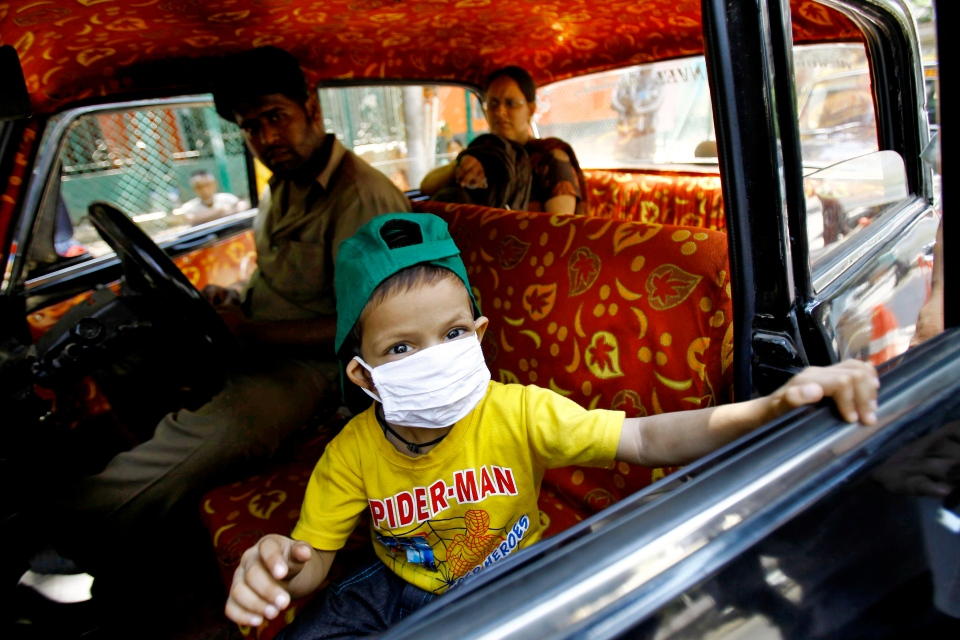 Tanmay, 4, who is suffering from cancer, leaves after getting treatment at Tata cancer hospital in Mumbai, India, Monday, April 1, 2013. (AP / Rafiq Maqbool)
