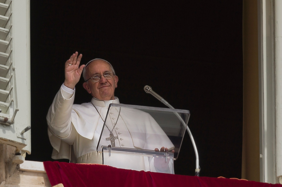 Pope Francis speaks before the Regina Coeli prayer from the window of his studio overlooking St. Peter's Square at the Vatican, Monday, April 1, 2013. (AP / Domenico Stinellis)