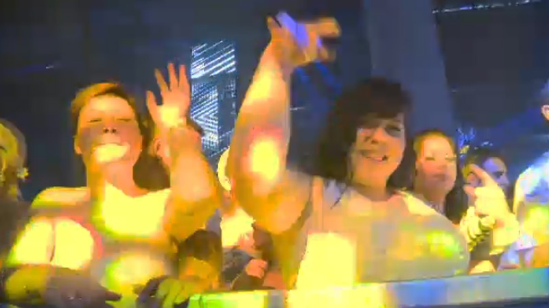 Glowstick-waving dancers bathed in flashing, multi-coloured lights throughout the night at the annual Bal en Blanc. (Image CTV Montreal).
