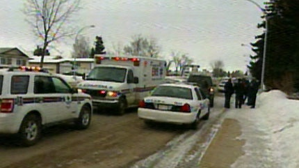 Police at the scene of a dog attack in the area of 77 St. and 144 Ave. on Feb. 15, 2011.