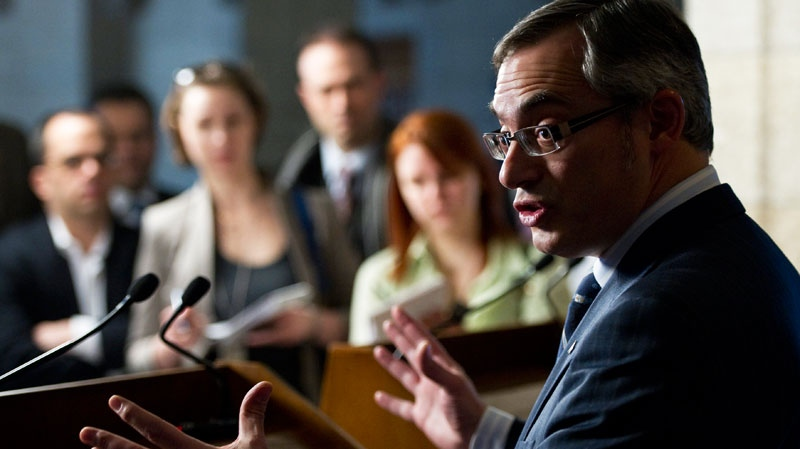 Industry Minister Tony Clement delivers a statement on the federal court's recent Globalive ruling on Parliament Hill in Ottawa Tuesday Feb. 15, 2011. (Sean Kilpatrick / THE CANADIAN PRESS)