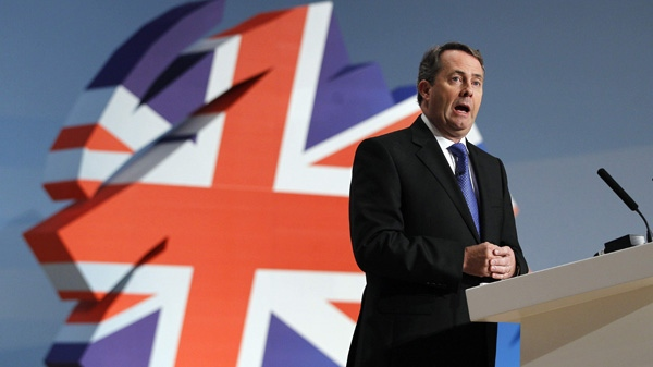 In this Oct. 6, 2010 file photo, Britain's Defence Secretary Liam Fox delivers a keynote speech at the Conservative party conference in Birmingham, England. (AP Photo/Kirsty Wigglesworth)