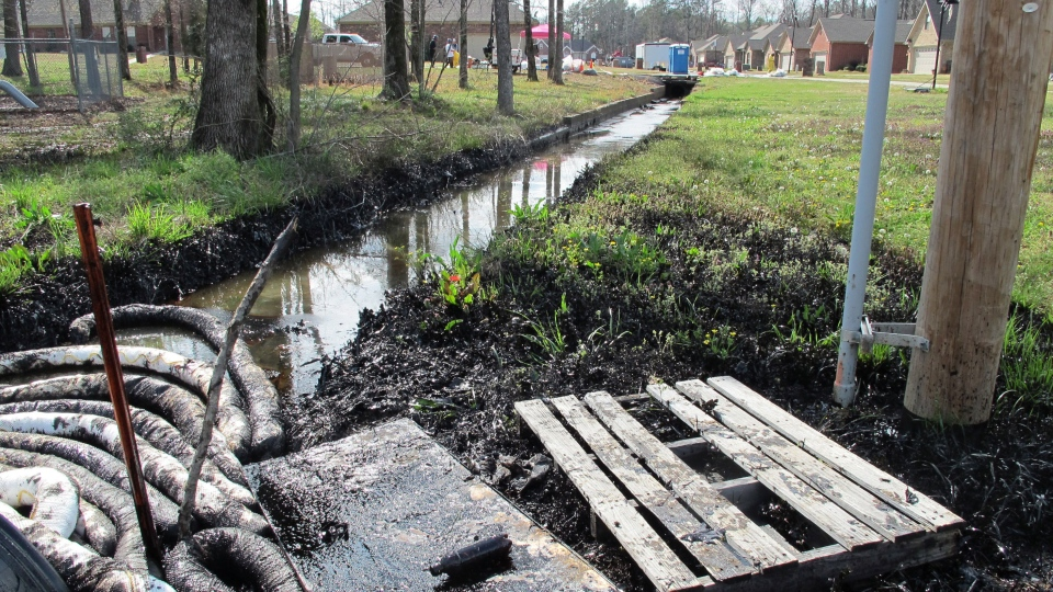 This photo taken Sunday, March 31, 2013 shows the Northwoods Subdivision in Mayflower, Ark., the site of where a petroleum line ruptured near a drainage ditch, leaking oil into a stream leading into Lake Conway. (AP / The Log Cabin Democrat, Alan English)