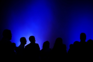 In this April 1, 2011 file photo, people are silhouetted by blue light as they stand in the fog during a mass commemorating World Autism Awareness Day in Rio de Janeiro, Brazil. (AP Photo/Felipe Dana)
