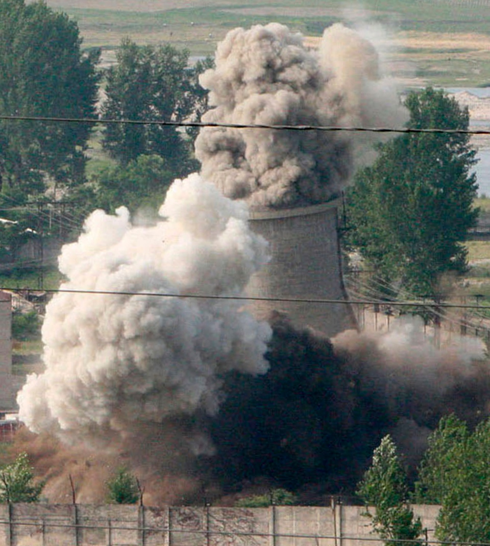 The cooling tower of the Nyongbyon nuclear complex is demolished in Nyongbyon, also known as Yongbyon, North Korea, June 27, 2008. (Xinhua / Gao Haorong)