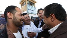 A Libyan Islamic prisoner, second left, is hugged by his relatives after he was released with a group of 110 prisoners from Abu Salim, Libya's most notorious prison, in Tripoli, Libya, Wednesday, Feb. 16, 2011. (AP / Abdel Magid Al Fergany)