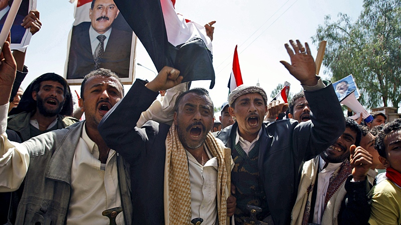 Supporters of the Yemeni government shout slogans as they try to enter Sanaa University where anti-government protestors gather, in Sanaa, Yemen, Wednesday, Feb. 16, 2011. (AP / Hani Mohammed)