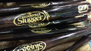 In this Thursday, March 28, 2013 photo, Louisville Slugger baseball bats are shown, in Louisville, Ky. (AP Photo/Brett Barrouquere)