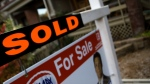 A for sale sign sits on the lawn of a house in Toronto in this undated file photo. (Maurice Cacho/CTV News)