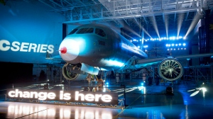 Bombardier unveils its CSeries flight test vehicle Thursday, March 7, 2013 in Mirabel, Que. Bombardier expect its first flight test by the end of June of this year. THE CANADIAN PRESS/Paul Chiasson