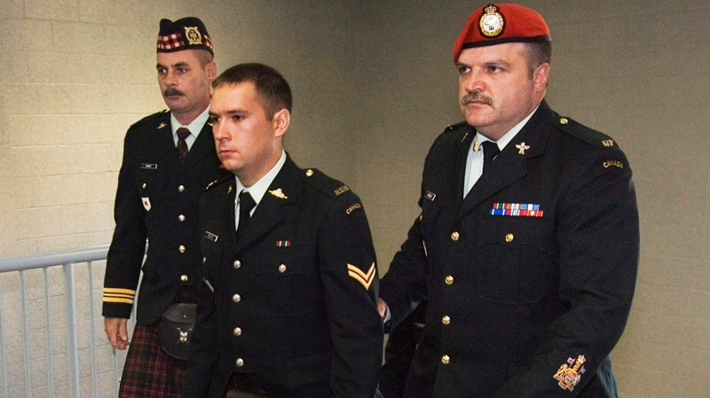 Cpl. Matthew Wilcox of Glace Bay, N.S., is escorted at his court martial during a break in proceedings in Sydney, N.S. on Wednesday, Sept. 30, 2009. (Andrew Vaughan / THE CANADIAN PRESS)