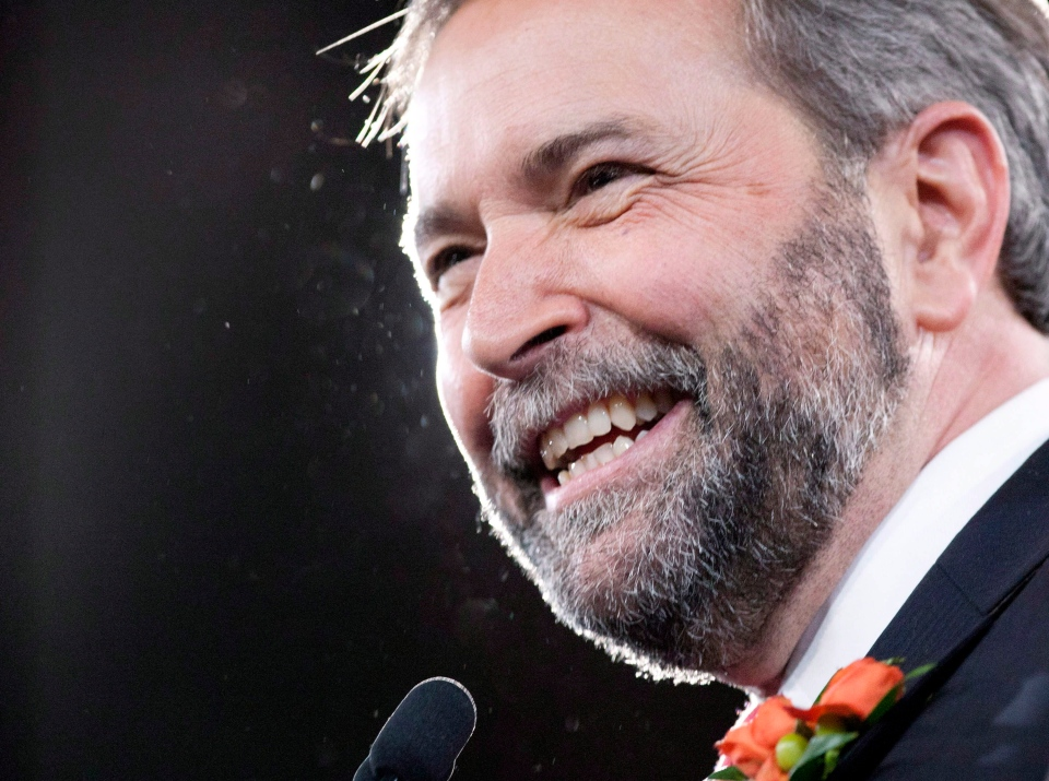 NDP leader Thomas Mulcair smiles on stage during the NDP leadership convention in Toronto on Saturday, March 24, 2012. (Chris Young / THE CANADIAN PRESS)