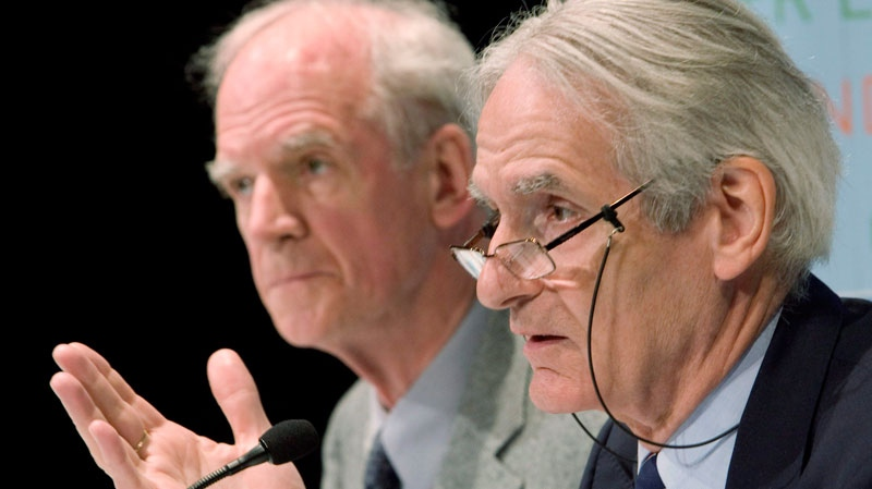 Philosopher Charles Taylor, left, and sociologist Gerard Bouchard speak to the media after releasing their report in Montreal Thursday, May 22, 2008 . (Ryan Remiorz / THE CANADIAN PRESS)