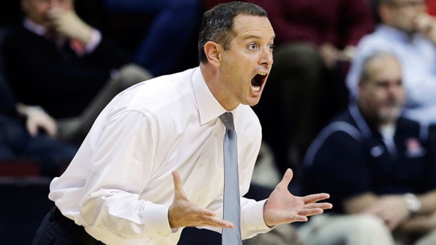 Mike Rice yelling while coaching basketball game