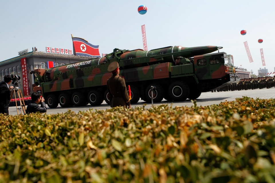 A North Korean vehicle carrying what appears to be a new missile passes by during a mass military parade in Pyongyang's Kim Il Sung Square to celebrate the centenary of the birth of the late North Korean founder Kim Il Sung, Sunday, April 15, 2012. (AP / Ng Han Guan)