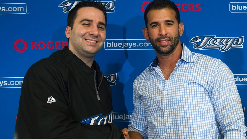 Toronto Blue Jays Senior Vice President of Baseball Operations and General Manager Alex Anthopoulos, left, and Blue Jays slugger Jose Bautista pose for a photograph after Bautista signed a five-year, multi-million-dollar deal at baseball spring training in Dunedin, Fla., on Thursday, Feb. 17, 2011. (Nathan Denette / THE CANADIAN PRESS)