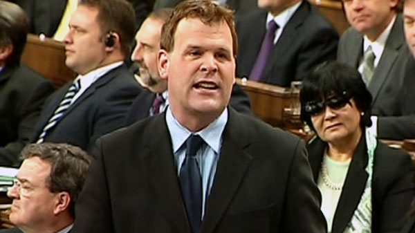 Leader of the Government in the House of Commons John Baird responds to a question as Minister of International Cooperation Bev Oda looks on during question period in the House of Commons on Parliament Hill in Ottawa Thursday, Feb. 17, 2011.