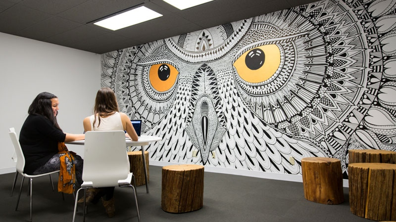 "Vancouver-based digital media giant HootSuite unveiled its new Vancouver office to journalists on April 4, 2013. The dog-friendly, open concept space includes a yoga studio, 24-hour gym, log benches, pup tents for meeting spaces, picnic tables, and nap room, complete with calming images and blankets so the company's ""owls"" can take a quick power nap. Photos courtesy of HootSuite."