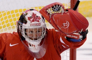 In this file photo, Team Canada's Charline Labonte makes a glove save against Team Switzerland during IIHF Women's World Hockey Championship action in Ottawa on Wednesday April 3, 2013. (Sean Kilpatrick / THE CANADIAN PRESS)