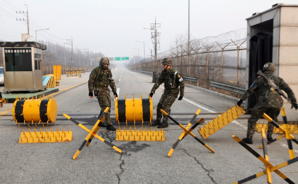 South Korean Army soldiers move barricades to pass vehicles at a military check point in Paju, South Korea, near the border village of Panmunjom, Thursday, April 4, 2013. (AP / Ahn Young-joon)