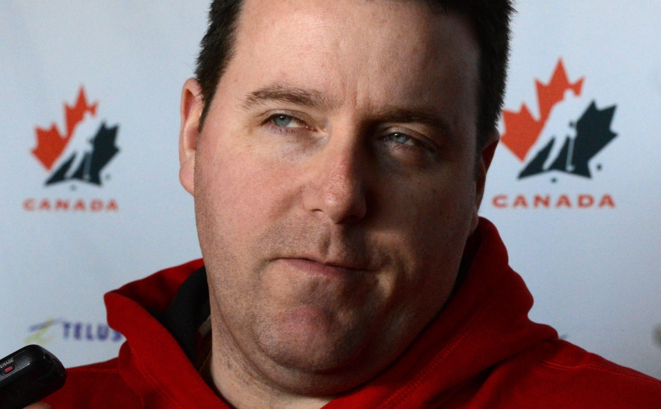 Team Canada's head coach Dan Church speaks to reporters during an off day at the IIHF Women's World Hockey Championships in Ottawa on Thursday April 4, 2013. (Sean Kilpatrick / THE CANADIAN PRESS)