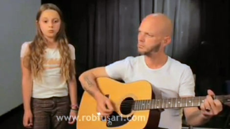 10-year-old Toronto native, Heather Russell, left, performs one of her songs in this undated image taken from video.