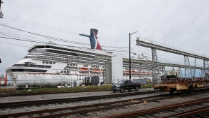 The Carnival cruise ship Triumph rests against a dock on the east side of the Mobile River after becoming dislodged from its mooring at BAE Shipyard during high winds in Mobile, Ala., on Wednesday, April 3, 2013. (AP  AL.com, Bill Starling)