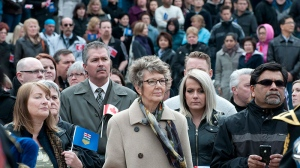 A large crowd looks on during a public memorial service for former premier, and Calgary mayor, Ralph Klein at city hall in Calgary on Friday, April 5, 2013. (Larry MacDougal / THE CANADIAN PRESS)