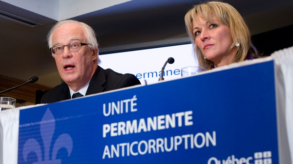 Public Security Minister Robert Dutil and Labour Minister Lise Theriault release details of a new plan to fight corruption in Quebec during a news conference in Montreal, Friday, Feb. 18, 2011. (Paul Chiasson / THE CANADIAN PRESS)
