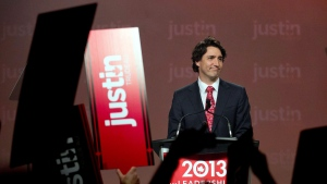 Liberal leadership candidate Justin Trudeau arrives on stage before speaking during the 2013 Liberal Leadership National Showcase in Toronto on Saturday, April 6, 2013. (Nathan Denette / THE CANADIAN PRESS)