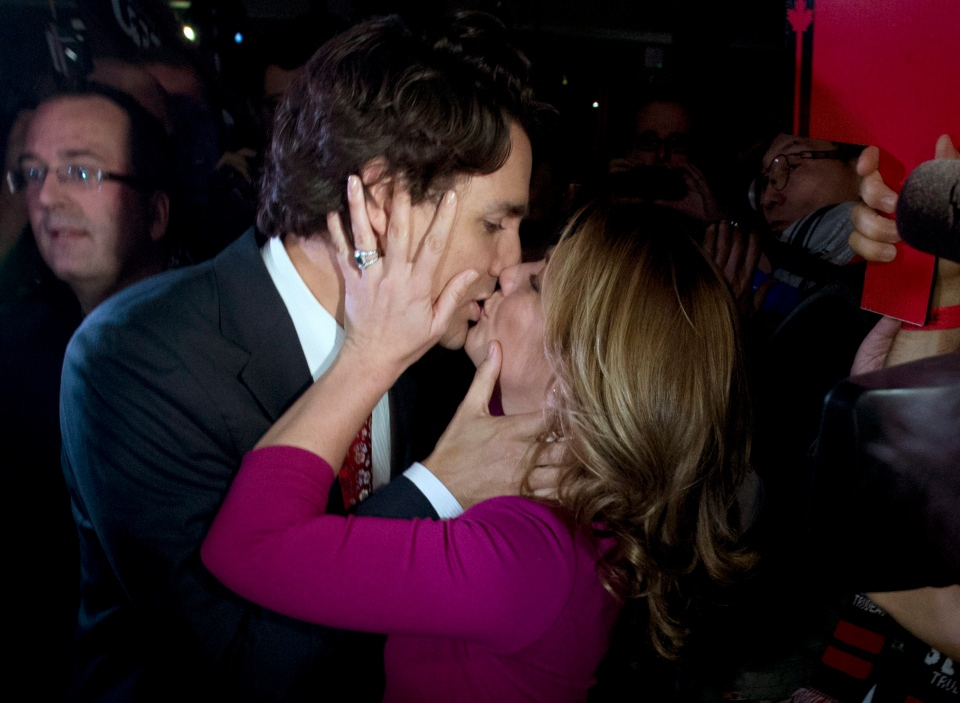 Liberal leadership candidate Justin Trudeau kisses his wife Sophie Gregoire-Trudeau during the 2013 Liberal Leadership National Showcase in Toronto on Saturday, April 6, 2013. (Justin Tang/ THE CANADIAN PRESS)