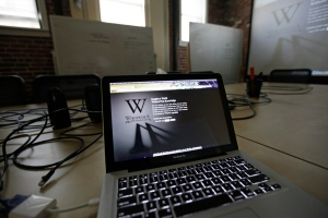 A blackout Wikipedia landing page is displayed on a laptop computer screen in this January 2012 file photo. (AP / Eric Risberg)