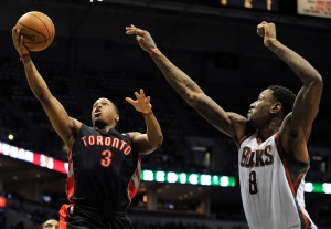 Toronto Raptors' Kyle Lowry drives to the basket as Milwaukee Bucks' Larry Sanders defends during the first half of an NBA basketball game Saturday, April 6, 2013, in Milwaukee. (AP / Jim Prisching)