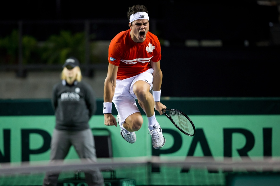 Canada's Milos Raonic celebrates after defeating Italy's Andreas Seppi during the fourth set of a Davis Cup tennis quarter-final singles match in Vancouver, B.C., on Sunday April 7, 2013. (Darryl Dyck / THE CANADIAN PRESS)