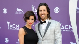 Jake Owen, right, and Lacey Buchanan arrive at the 48th Annual Academy of Country Music Awards at the MGM Grand Garden Arena in Las Vegas on Sunday, April 7, 2013. (Photo by Al Powers / Invision)