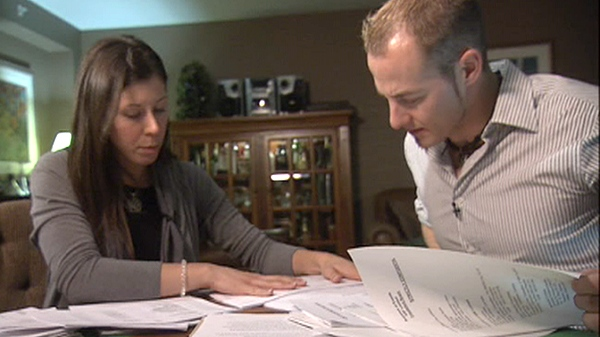 Nick Djokich's children, Steve and Jennifer, comb through their father's investigation documents.
