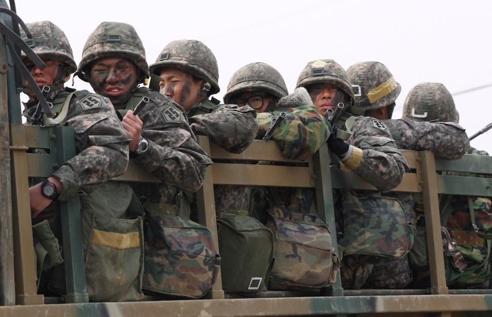 South Korean army soldiers on a military truck move during an exercise against possible attacks by North Korea in Pocheon, South Korea, near the border with North Korea on April 8, 2013. (AP Photo/Ahn Yong-joon)