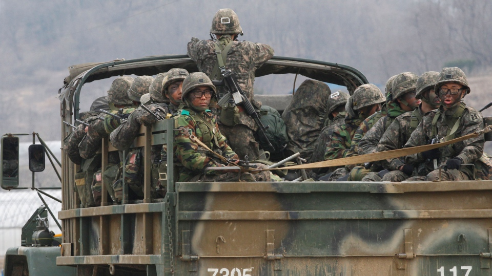 South Korean army soldiers on a military truck move during an exercise against possible attacks by North Korea in Pocheon, South Korea, near the border with North Korea, Monday, April 8, 2013. (AP / Ahn Yong-joon)