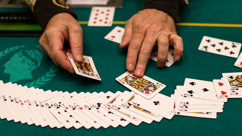 Jeff Martos resets a deck of cards during a break in poker play at Caesar's Palace, Wednesday, Feb. 27, 2013, in Las Vegas. (AP / Julie Jacobson)