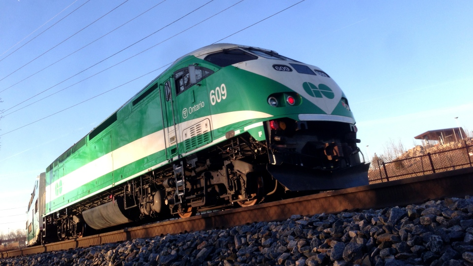 A GO Train passes along a stretch of tracks alongside the Don Valley Parkway in Toronto on Friday, April 5, 2013. (CTV Toronto/Maurice Cacho)