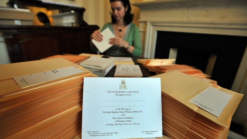 In this photo taken Wednesday Feb. 16, 2011 at Buckingham Palace in London, a member of the Lord Chamberlain's Office, no name given, places invitations into envelopes, to the wedding of Prince William and Kate Middleton, before posting them to the lucky guests who will be present at the April 29, 2011 royal wedding to be held in Westminster Abbey. (AP / PA, John Stillwell)