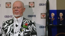 Hockey commentator Don Cherry stands next to his bobblehead doppelganger at a news conference in Calgary on Friday, Feb. 18, 2011. (Bill Graveland / THE CANADIAN PRESS)