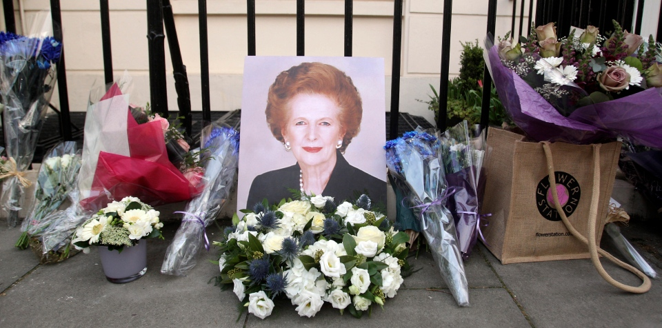 Flowers placed by well-wishers surround a portrait of former British prime minister Margaret Thatcher outside her home in Belgravia, London.  (PA / Lewis Whyld)
